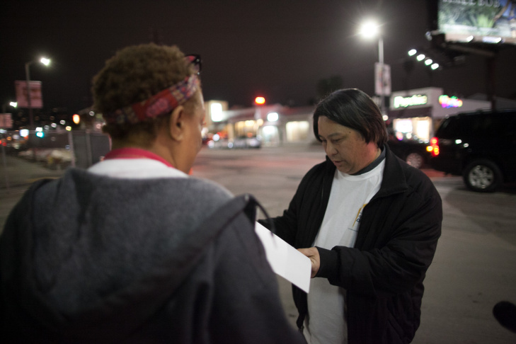 File: Volunteers count homeless people in the Mid Wilshire area of L.A. during the 2015 Greater Los Angeles Homeless Count conducted by the Los Angeles Homeless Services Authority on Jan. 29, 2015.