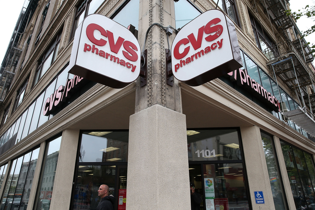 A pedestrian walks by a CVS store on June 15, 2015 in San Francisco, California.  CVS Health announced that it has agreed to acquire Target's pharmacy and clinic businesses for an estimated $1.9 billion.