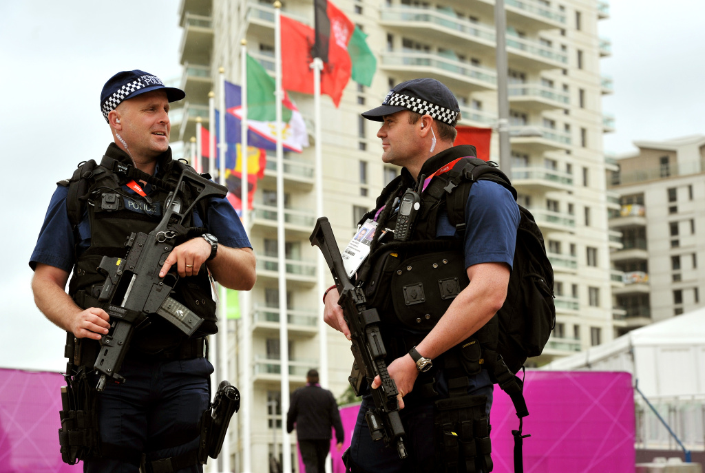 Armed police patrol around the Athletes' Village at the Olympic Park site on July 16, 2012 in Stratford, east London.  (Photo by John Stillwell - WPA Pool/Getty Images)