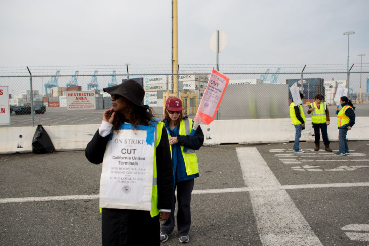 Port workers picket outside of the closed APM Terminal at the Port of Los Angeles. The protest is now in its second week.