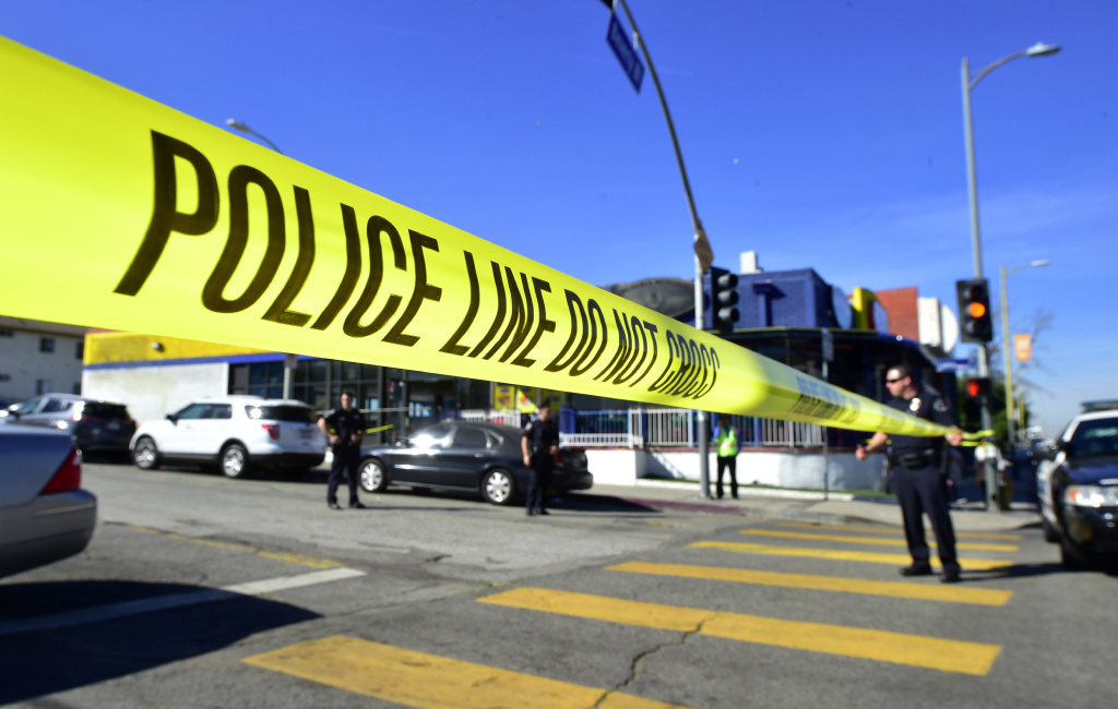 Police stand at a roadblock near Salvadore Castro Middle School in Los Angeles, California on February 1, 2018,