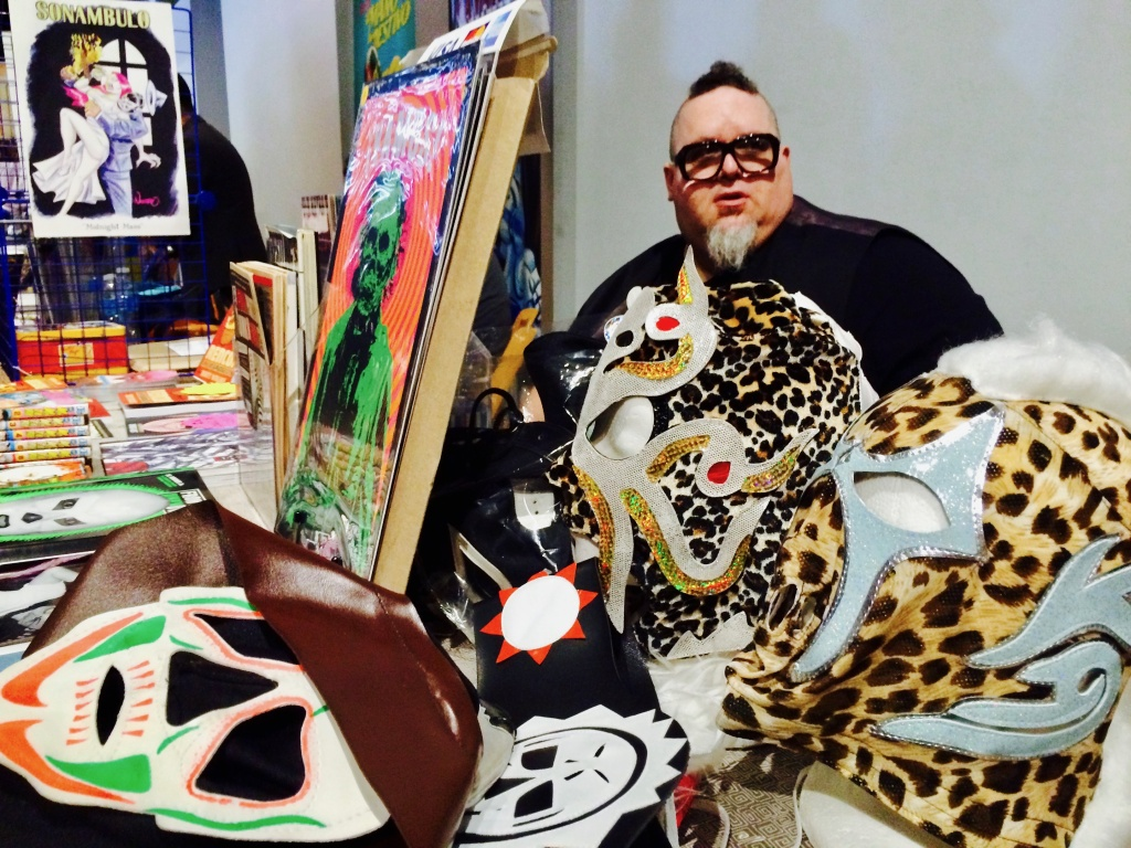Many Latino artists were inspired to create their work after growing up watching a steady stream of Lucha Libre, or Mexican wrestling. To pay homage, the Expo set up an area featuring all Lucha-themed merchandise. Pictured is Lucha Libre expert, Keith Ranville.