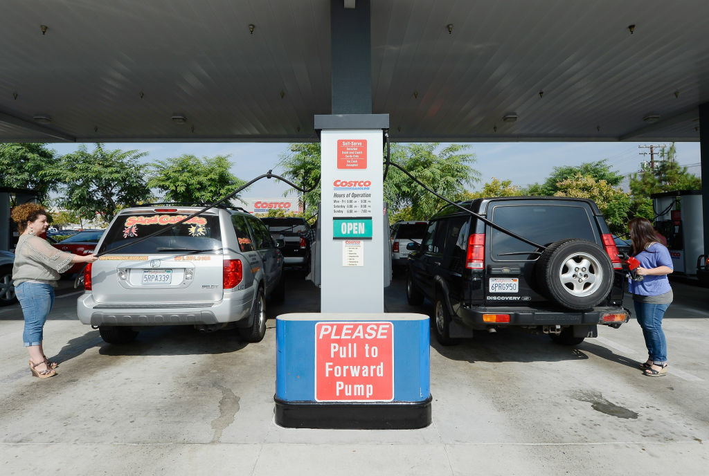 Customers gas up their car at a Costco store in Burbank.