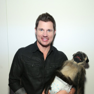 Nick Lachey and Puppy Monkey Baby visit the SiriusXM set at Super Bowl 50 Radio Row at the Moscone Center on Feb. 5, 2016 in San Francisco.