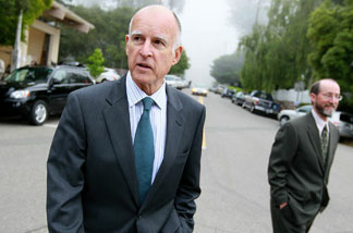 California Attorney General and democratic candidate for governor Jerry Brown (L) walks home with his campaign manager Steven Glazer after voting June 8, 2010 in Oakland, California.