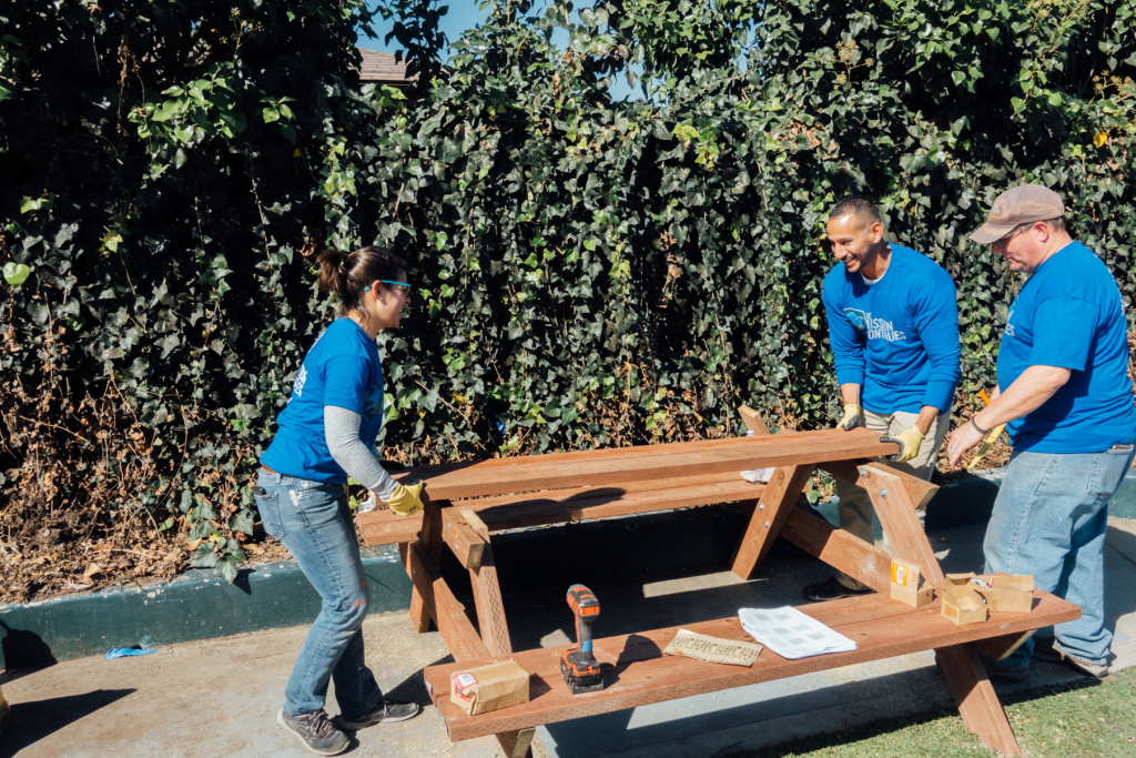 A picnic table comes together at Gonzaque Village in Watts during a volunteer event organized by The Mission Continues.