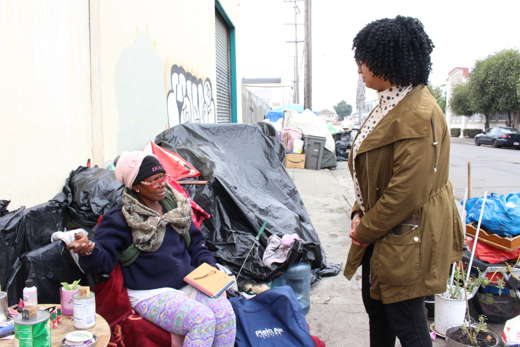 "Homeless advocate Candice Elder, 34, checks in with Dorothy Smith, 65, at an encampment in Oakland on Aug. 24, 2018. Smith, who raised her children in the city, said her disability benefits are not enough to afford housing. ""It just don't support me,"" she said."