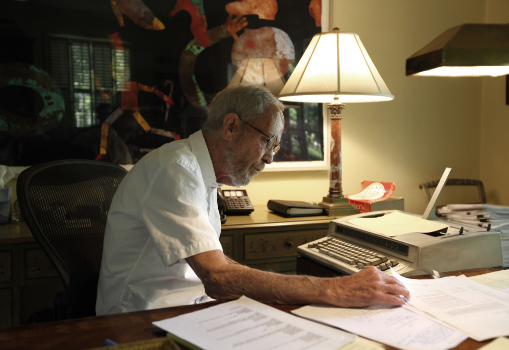 Crime novelist Elmore Leonard, 86, looks through papers at his Bloomfield Township, Mich., home Monday, Sept. 17, 2012. The best-selling author of