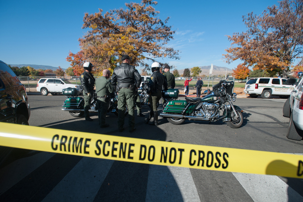 Police secure the scene near Sparks Middle School after a shooting in Sparks, Nev., on Monday, Oct. 21, 2013.  Authorities are reporting that two people were killed and two wounded at the Nevada middle school.