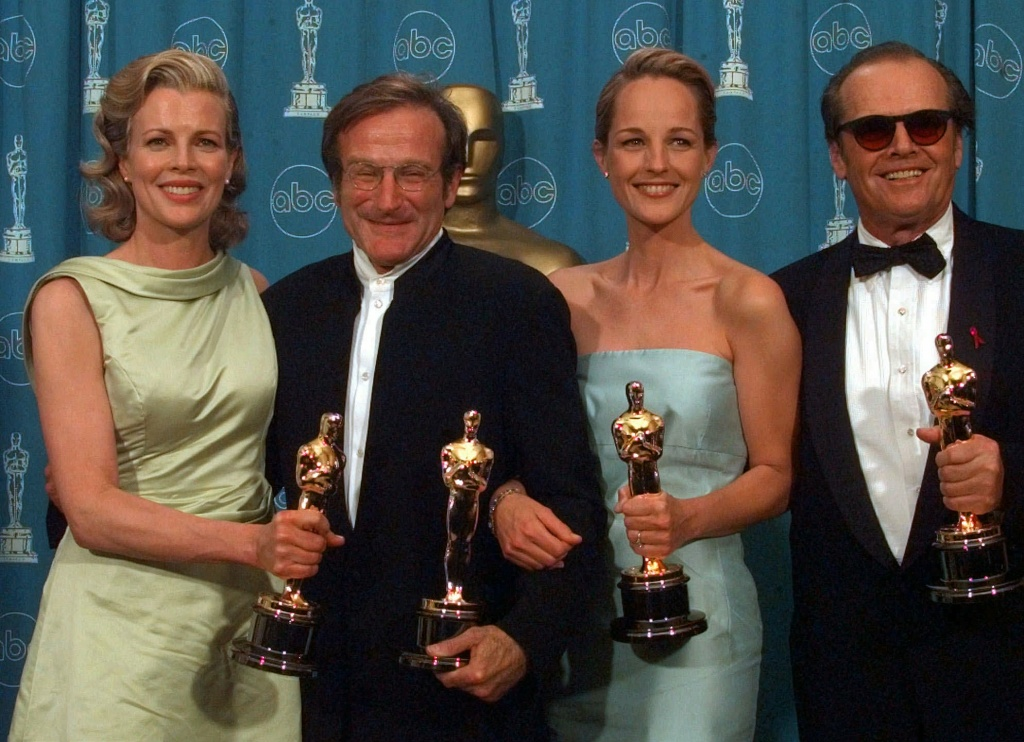 Kim Basinger, Robin Williams, Helen Hunt and Jack Nicholson, from left to right, pose with their Oscars at the Shrine Auditorium in Los Angeles, Monday, March 23, 1998. Basinger and Williams won Best Supporting Actress and Actor, for