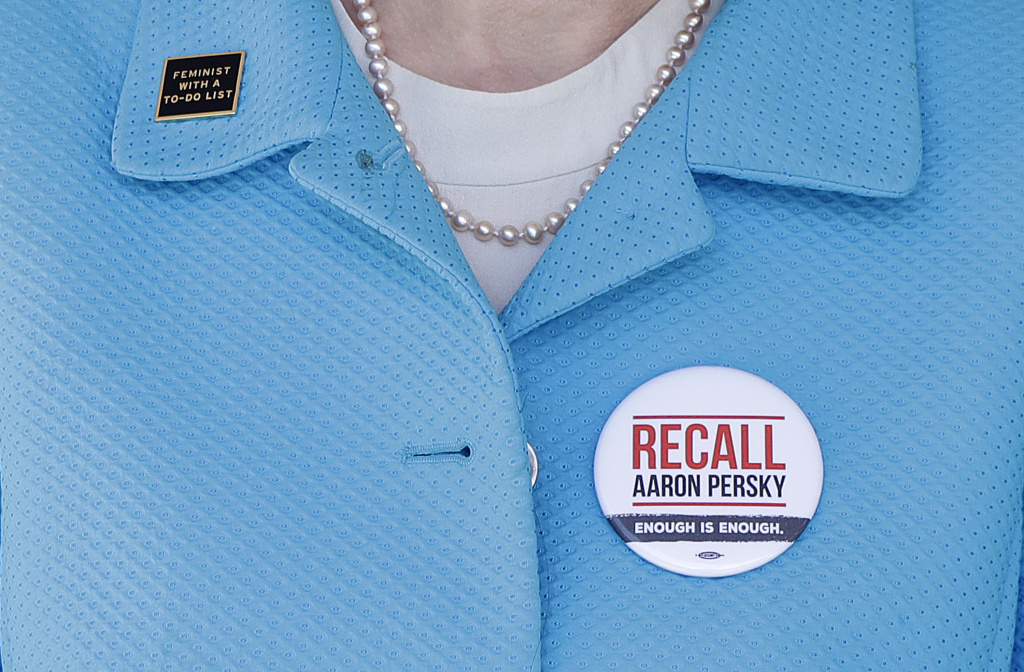 In this May 14, 2018 photo, Stanford law professor Michele Dauber wears a pin to recall Judge Aaron Persky outside of the Palo Alto Courthouse in Palo Alto, Calif.