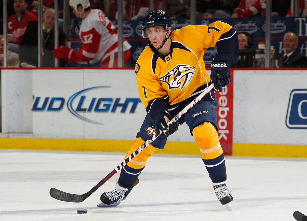 Jonathon Blum (#7) of the Nashville Predators looks to make a play against the Detroit Red Wings at Joe Louis Arena on February 23, 2013 in Detroit, Michigan.