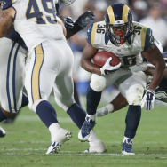 Running back Aaron Green #36 of the Los Angeles Rams carries the ball against the Dallas Cowboys at the Los Angeles Coliseum during preseason on August 13, 2016 in Los Angeles, California.