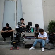 Film crew are seen waiting with their equipment in the 798 art district of Beijing.