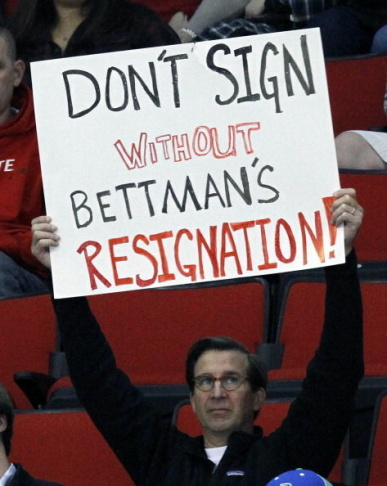 A fan shows holds up a sign showing his displeasure with NHL commissioner Gary Bettman while the Charlotte Checkers play the Norfolk Admirals in a American Hockey League hockey game at the PNC Arena on Sunday, January 6, 2013, in Raleigh, North Carolina. The Checkers are the Carolina Hurricanes highest-level minor league franchise.