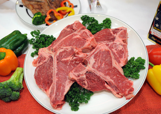 Imported T-bone steak from the US are seen during a food-tasting event at a market in Seoul on July 14, 2010.