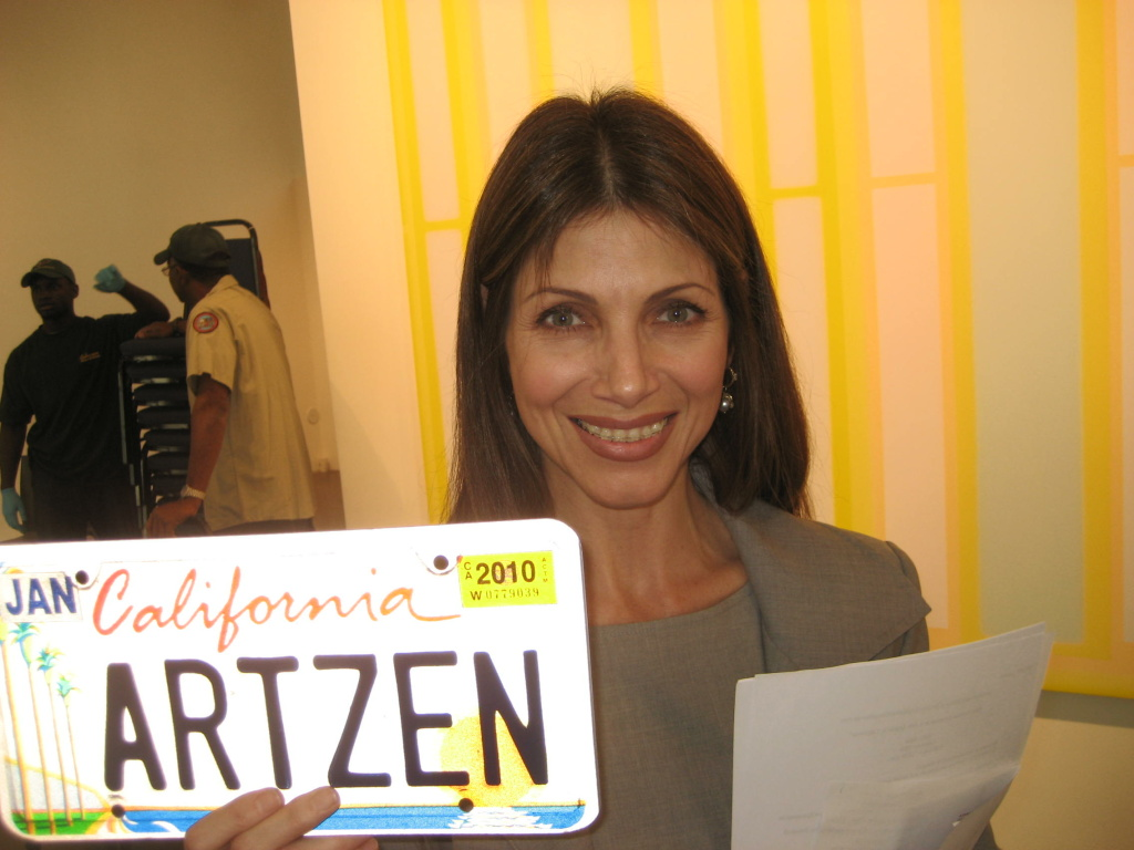 Malissa Feruzzi Shriver, Chair of the California Arts Council holds the California Arts license plate. Sales of the plates have raised more than $20 million for the arts in California