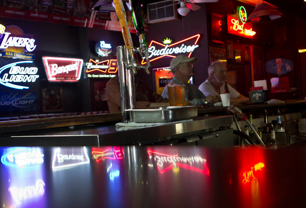 Patrons watch television at the bar in the King Eddy Saloon. Should California bars be allowed to serve alcohol until 4 a.m.?