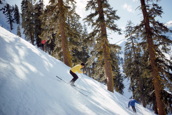 Scenic view of skiers in action on West Face of KT-22 at Squaw Valley Ski Resort.