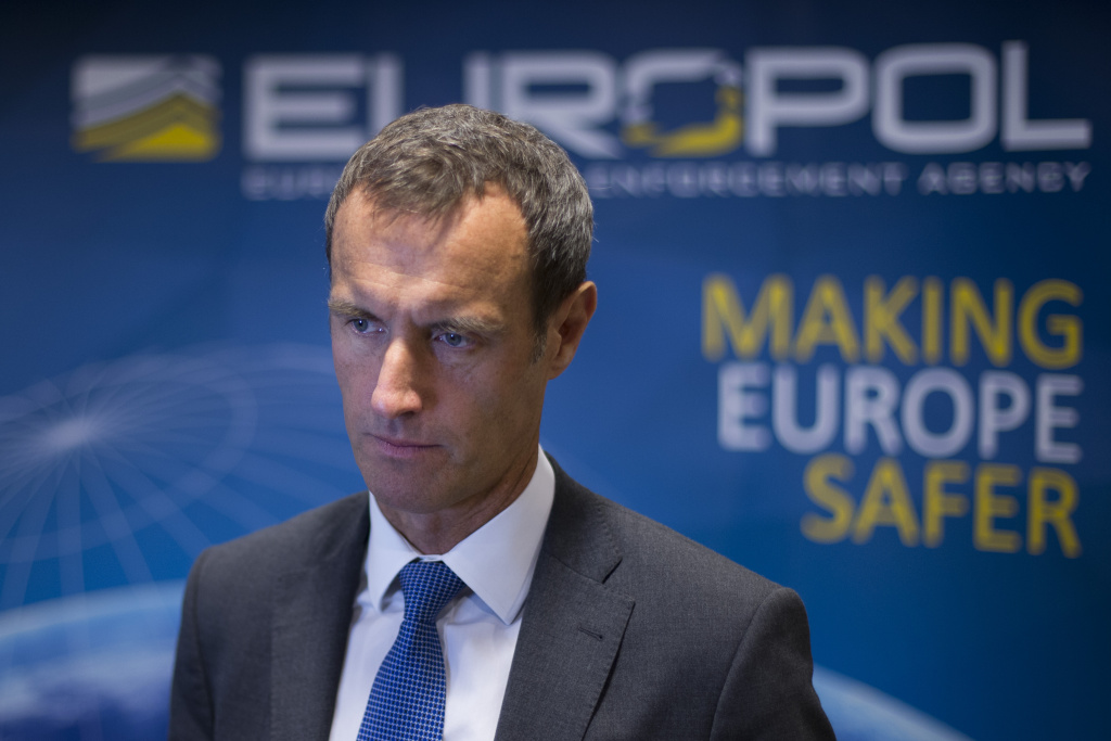 The head of the European police agency Europol, Rob Wainwright, right, answers questions during an interview in The Hague, Netherlands, Friday, Jan. 16, 2015. French and German authorities arrested at least 12 people Friday suspected of links to the Islamic State group and a Paris train station was evacuated, with Europe on alert for new potential terrorist attacks. The police raids came the morning after Belgian authorities moved swiftly to pre-empt what they called a major impending attack, killing two suspects in a firefight and arresting a third in a vast anti-terrorism sweep that stretched into the night.