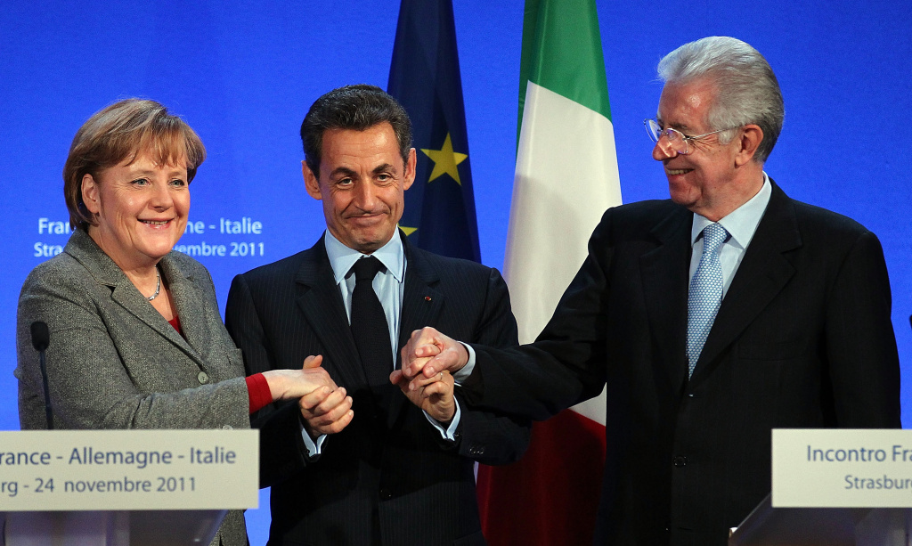 STRASBOURG, FRANCE - NOVEMBER 24:  French President Nicolas Sarkozy (C) shake hands with German Chancellor Angela Merkel (L) and Italian Prime Minister Mario Monti (R) on November 24, 2011 in Strasbourg, France. The three are meeting to seek agreement on how to resolve the Eurozone debt crisis as both Monti and Sarkozy are under pressure to reassure financial markets over the future of their respective countries' economies.  (Photo by Thomas Niedermueller/Getty Images)