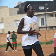 "Senegalese girls participate in a rugby match along with other youths at the ""House of Rugby"" sports and cultural center, in Yoff, a neighborhood of Dakar, on October 17, 2011."
