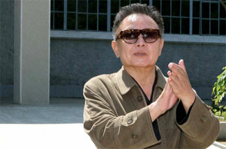 This undated picture, released from North Korea's official Korean Central News Agency on June 4, 2010, shows North Korean leader Kim Jong Il inspecting the machine plant managed by O Mun Hyon in North Pyangan province.