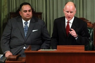 Gov. Jerry Brown delivers the state of the state address as Speaker of the Assembly John Perez (left) looks on at the California State Capitol on Jan. 31, 2011 in Sacramento.