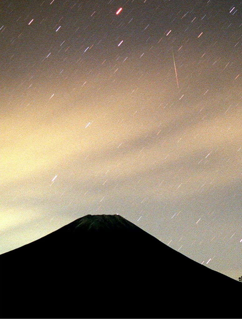 This photo shows fragments from the Leonids meteor shower over Mt. Fuji in the early hours of 18 November at Fujinomiya city in the Shizuoka prefecture of Japan.