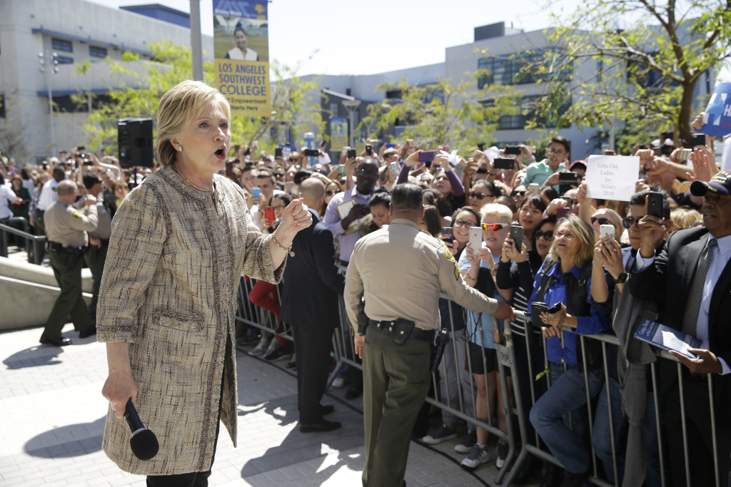 Democratic presidential candidate Hillary Clinton addresses supporters in the overflow area during a campaign event at the Los Angeles Southwest College on Saturday, April 16, 2016, in Los Angeles. (AP Photo/Jae C. Hong)