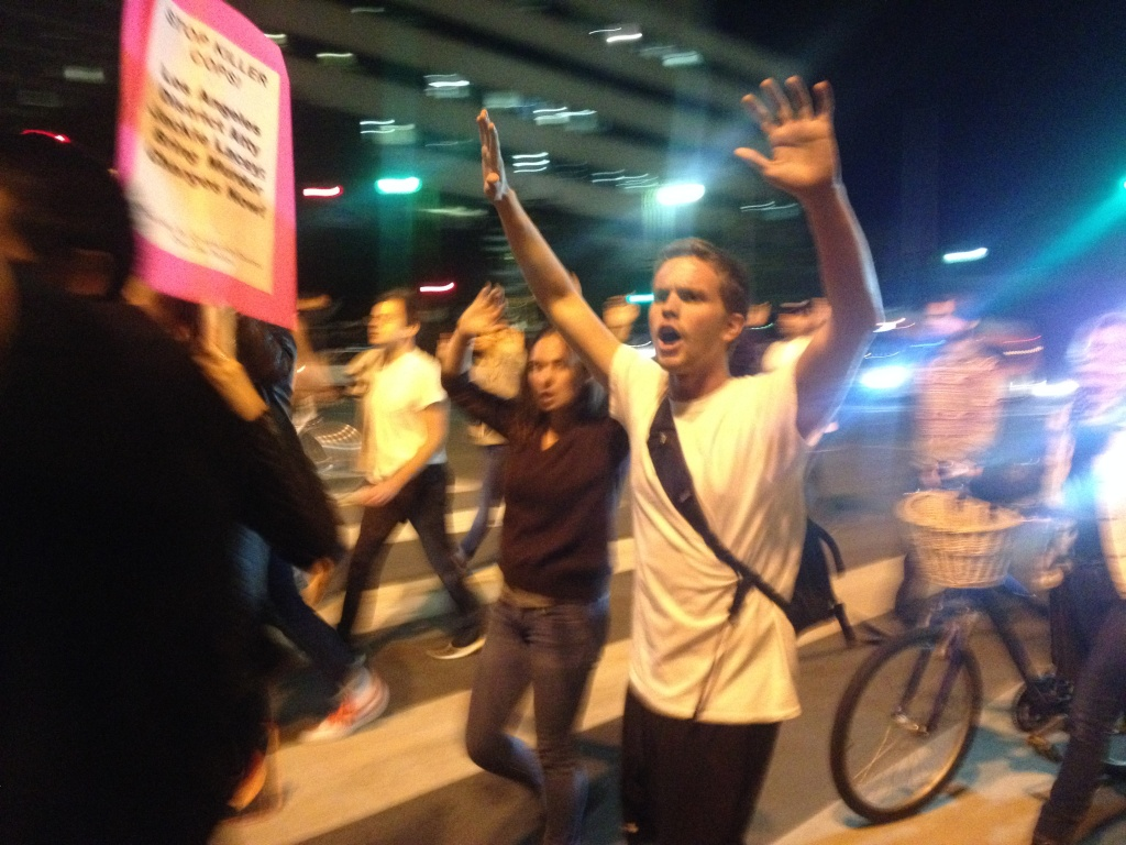 Protesters arrive at LAPD headquarters Wednesday night around 8 p.m. after marching from Crenshaw and Martin Luther King boulevards around 4 p.m. Dozens of LAPD cops stood in lines in front of the headquarters building wearing helmets. There were metal barricades around the headquarters.