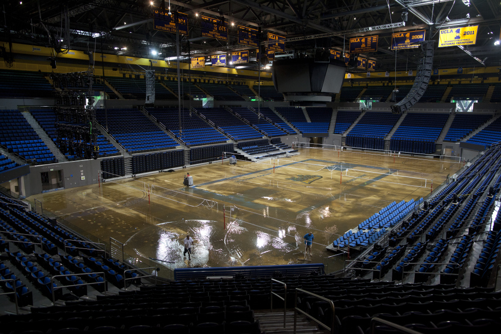 Water covers the court inside the Pauley Pavilion after a broken water main flooded the UCLA campus.
