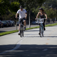 In Burbank, a couple ride their bikes along a bike path median built along West Chandler Boulevard. This path is an example of what the Metropolitan Transportation Authority is considering creating along Slauson Avenue in South L.A.