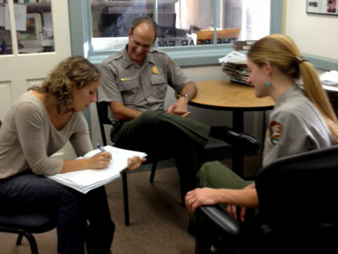 Dr. Danielle Buttke a veterinary epidemiologist with the National Park Service Office of Public Health talks with Yosemite rangers and public information officers Scott Gediman and Kari Cobb about the hantavirus outbreak at the park.