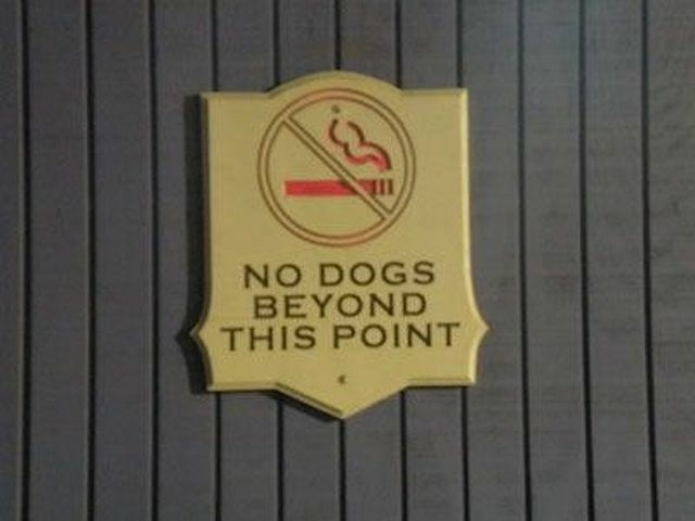 Real sign hanging on a Santa Monica Pier building, circa 2008.