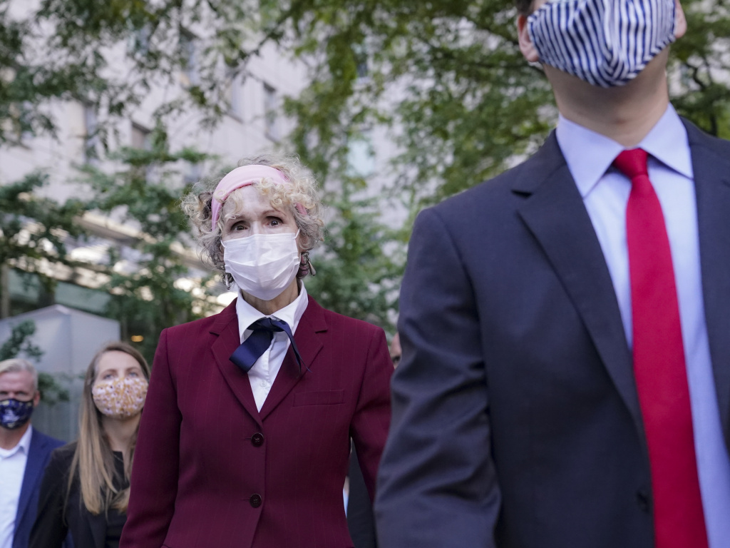 E. Jean Carroll (left), who has accused President Trump of raping her in the 1990s, leaves federal court in New York City after a hearing last week in her defamation lawsuit.
