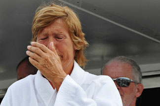 KEY WEST, FL - AUGUST 9: In this handout provided by Florida Keys News Bureau, Diana Nyad reacts as she speaks to reporters and fans after arriving back in Florida, following the 61-year-old marathon swimmer's failed attempt to swim from Cuba to the Florida Keys August 9, 2011 in Key West, Florida. Nyad's second attempt in 33 years to swim from Cuba to Florida ended after 29 hours because of wind, currents and health problems.
