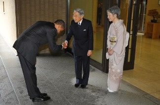 US President Barack Obama bows as he shakes hands with Japanese Emperor Akihito and as Empress Michiko looks on upon Obama's arrival at the Imperial Palace in Tokyo on November 14, 2009. The Japanese bow from the waist while the Chinese bow with the shoulders and a head nod. Obama and his team will be paying close attention to proper protocol while hosting Chinese President Hu Jintao at a state dinner Wednesday night.