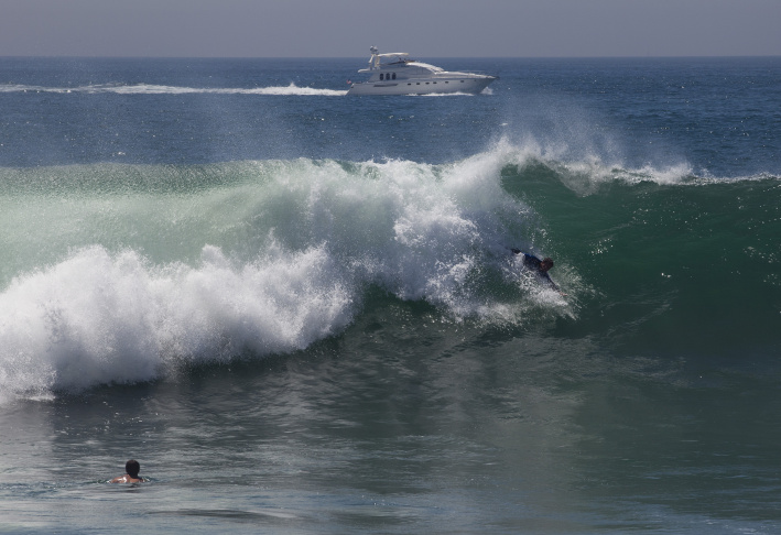 A body surfer catches a wave at the Wedge in Newport Beach as Hurricane Marie brings a big swell to the coast.