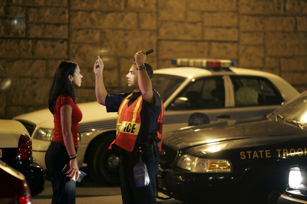 Officer Kevin Millan from the City of Miami Beach police department conducts a field sobriety test at a DUI traffic checkpoint in Miami, Florida.