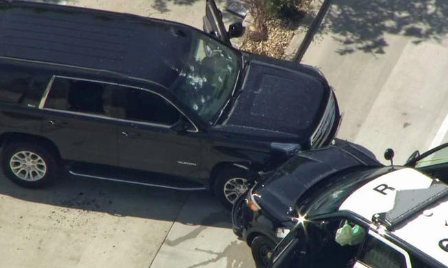 Aerial footage from NBC4 showed a cop car had been involved in a crash with a black SUV that was riddled with bullet holes.