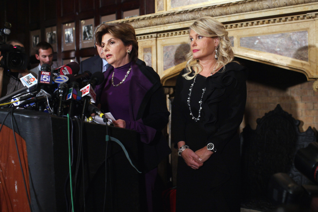 Sharon Bialek (R) listens as her attorney Gloria Allred (L) speaks during a news conference to accuse Republican presidential candidate Herman Cain of sexual harassment more than a decade ago on Nov. 7, 2011, in New York City. Bialek is the fourth woman to accuse Cain of inappropriate behavior when he was the CEO of the National Restaurant Association.