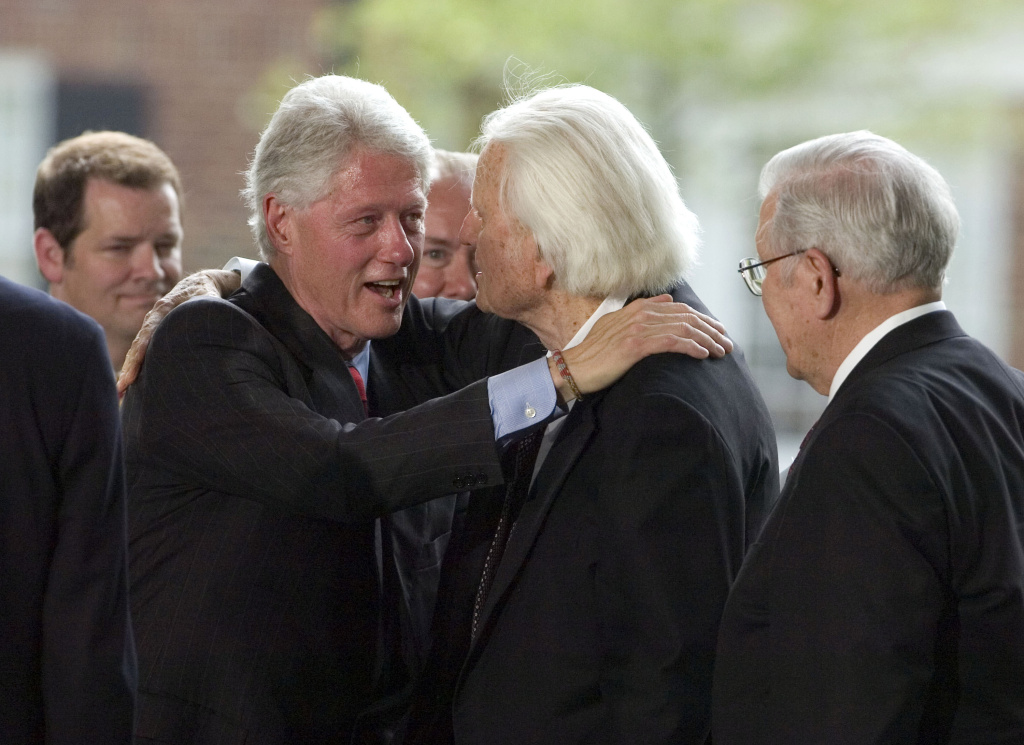 Evangelist Billy Graham is greeted by former U.S. President Bill Clinton on the stage during the Billy Graham Library Dedication Service on May 31, 2007 in Charlotte, North Carolina.