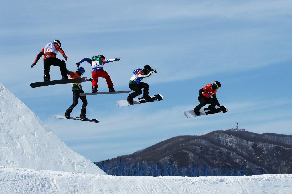 Men compete during the snowboard cross quarterfinals at the 2018 Pyeongchang Winter Olympics.