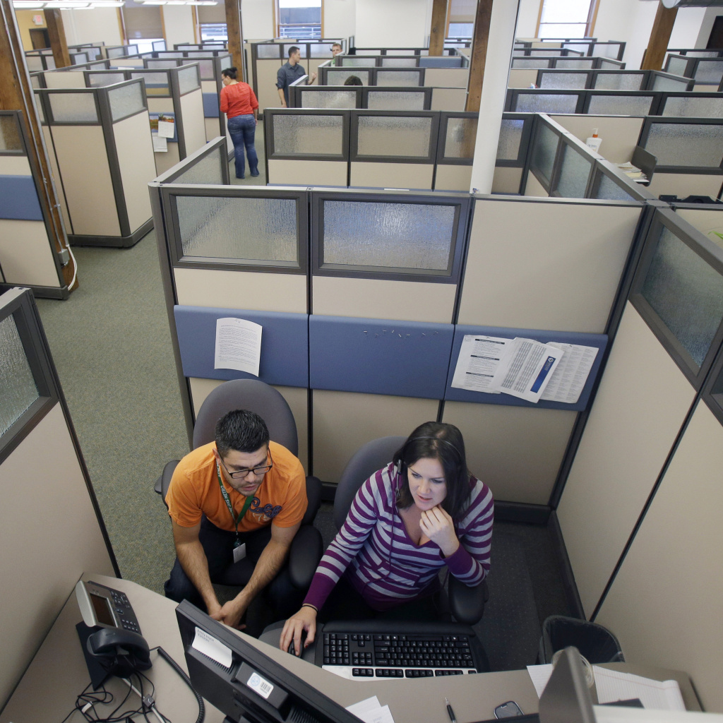 Workers at a Minnesota health care exchange prepare for opening day on Tuesday.