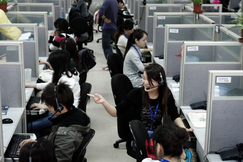 This photo taken on March 9, 2011 shows employees at China-based company Ctrip in the call center of their headquarters in Shanghai. The one-stop China travel service Ctrip.com specializes in discount hotel reservations, cheap airline tickets and package tours.