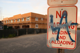 Graffiti is seen on a sign near a new townhouse construction site March 3, 2009 in Compton, California.