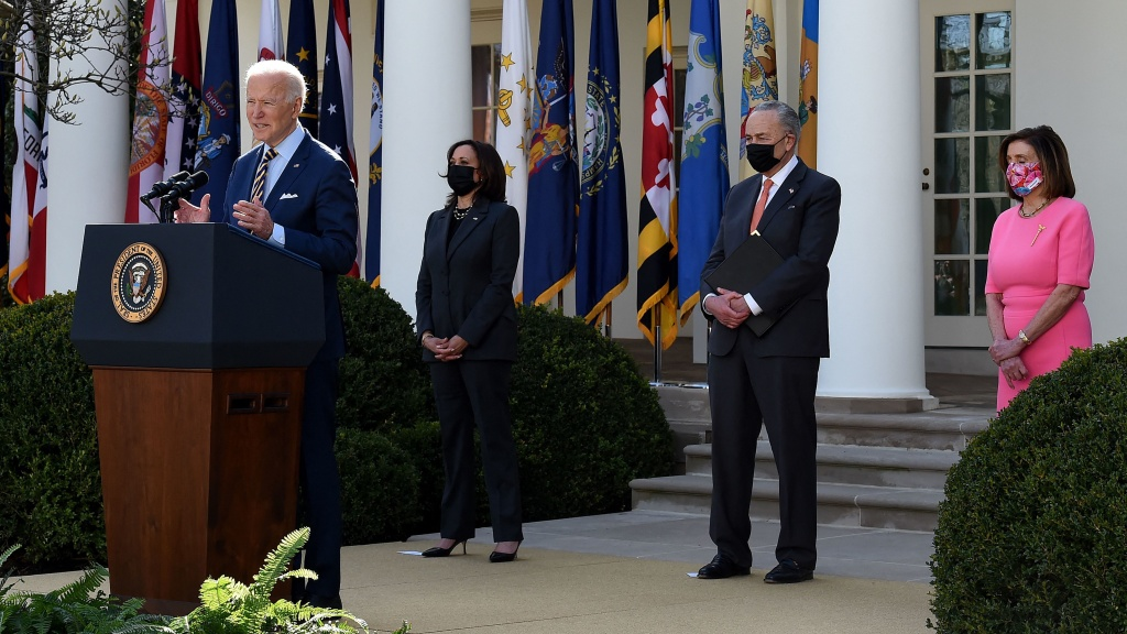 President Biden, with (L-R) Vice President Kamala Harris, Senate Majority Leader Chuck Schumer, and House Speaker Nancy Pelosi, Democrat of California, speaks about the American Rescue Plan in the Rose Garden of the White House on Friday.