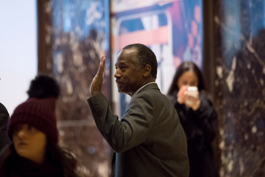 Former Republican presidential hopeful Ben Carson waves as he leaves Trump Tower, November 22, 2016 in New York City.
