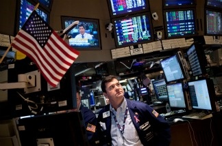 Traders at the New York Stock Exchange keep a close eye on the debt crisis talks, as The Dow continued a week-long decline.